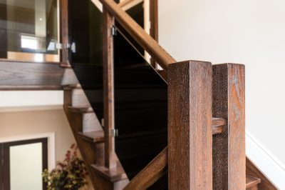 custom staircase with tinted glass railing