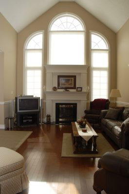 Curved windows above and around fireplace
