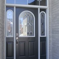entry door with transom and rounded side lights and glass insert
