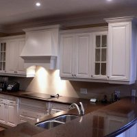 Glass and Solid Wood Cabinets in White Kitchen