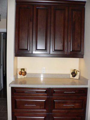 Dark wood kitchen cabinets