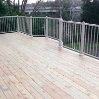 wood deck with metal railing - deck builder