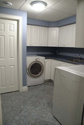 laundry room with counter and cabinets