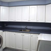 laundry with upper and lower cabinets