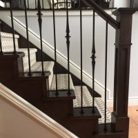 stair case with wrought iron railing