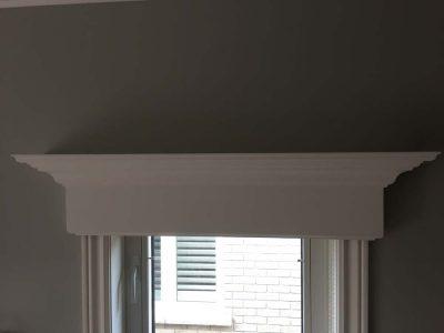 detailed trim above windows